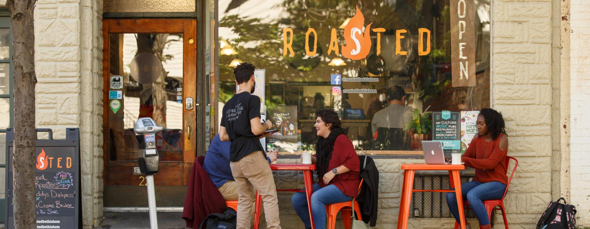 people eating at Roasted